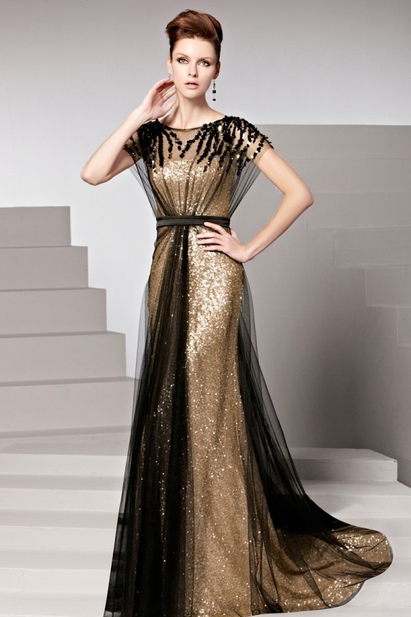 dbd997c3448 Robe dorée tulle noir pailletée ceinturée ornée de rhinestones · robe longue  de soirée bicolore avec paillettes
